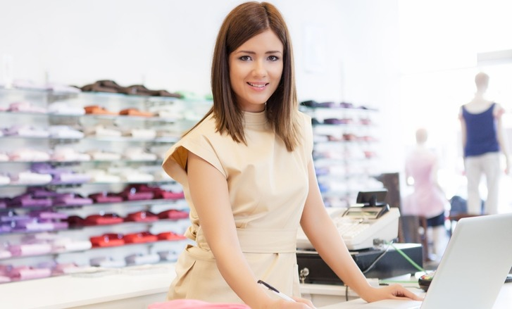 Retail apprentice at work in fashion store